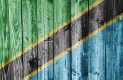 Flagga av Tanzania på ridit ut trä Fotografering för Bildbyråer