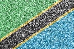 Flagga av Tanzania på vallmofrö Royaltyfri Foto