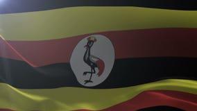 Flagga av Uganda som vinkar på flaggstången i vinden, nationellt symbol av frihet stock illustrationer