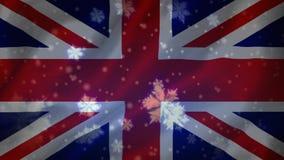 Flagga av UK och snöflingorna stock video