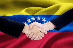 Flagga av Venezuela med att handla handskakningen Royaltyfria Foton