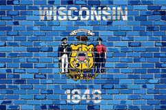 Flagga av Wisconsin på en tegelstenvägg stock illustrationer