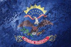 Flagga för GrungeNorth Dakota stat Gru för North Dakota flaggabakgrund royaltyfria bilder