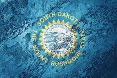 Flagga för GrungeSouth Dakota stat Gru för South Dakota flaggabakgrund arkivbilder