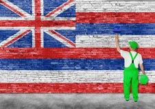 Flagga för målarfärger för husmålare av Hawaii på tegelstenväggen Arkivfoto