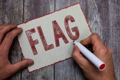 Flagga för ordhandstiltext Affärsidé för emblem av ett lands- och institutionstycke av torkduken som fästas till en pol royaltyfria bilder