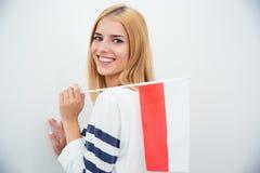 Flagga för kvinnainnehavpolermedel Fotografering för Bildbyråer