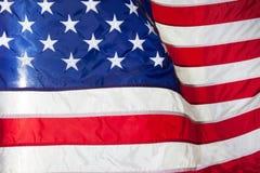 flagga USA amerikanska flaggan Amerikanska flaggan som blåser vind Arkivbild
