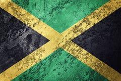 flaggagrunge jamaica Jamaica flagga med grungetextur Arkivbilder