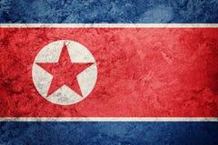 flaggagrunge norr korea Nordkorea flagga med grungetextur Arkivfoton