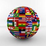 Flaggajordklot med olika landsflaggor Arkivbild