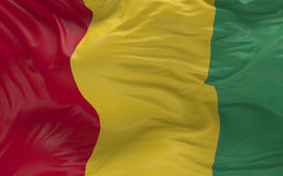 Flaggan av Guinea som vinkar i vinden 3d, framför Arkivbilder