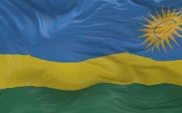 Flaggan av Rwanda som vinkar i vinden 3d, framför Arkivbilder