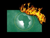Flagge Burning - Afrikanische Union Stockbild