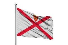 Flagge des Machtbereiches von Jersey wellenartig bewegend in den Wind, lokalisierter weißer Hintergrund stockbild
