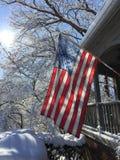 Flagge am ersten Schnee Stockfotos