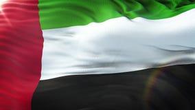 Flagge Vereinigte Arabische Emirates, das auf Sonne wellenartig bewegt Nahtlose Schleife mit in hohem Grade ausführlicher Gewebeb stock abbildung