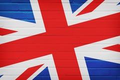 FLAGGE Vereinigten K?nigreichs GEMALT AUF BACKSTEINMAUER lizenzfreie stockfotos