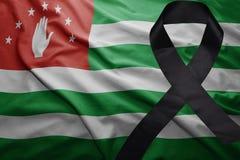 Flagge von Abchasien mit schwarzem Trauerband Lizenzfreie Stockfotografie