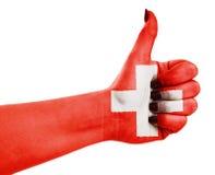 Flagge von der Schweiz an Hand Stockfoto