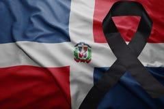 Flagge von Dominikanischer Republik mit schwarzem Trauerband Lizenzfreies Stockfoto