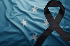 Flagge von Federated States of Micronesia mit schwarzem Trauerband Lizenzfreie Stockbilder