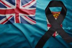 Flagge von Fidschi mit schwarzem Trauerband Lizenzfreies Stockfoto
