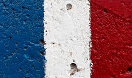 Flagge von Frankreich auf Betonmauer Stockbilder