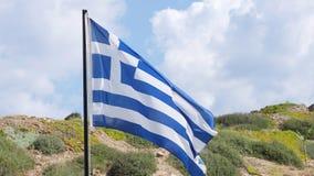 Flagge von Griechenland auf dem Fahnenmast Stockfotografie