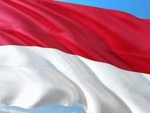 Flagge von Indonesien wellenartig bewegend in den Wind gegen tiefen blauen Himmel Gewebe der hohen Qualit?t stockbilder