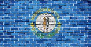 Flagge von Kentucky auf einer Backsteinmauer Stockbilder