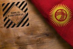 Flagge von Kirgisistan machte herein Stockbild