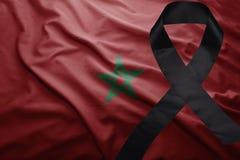 Flagge von Marokko mit schwarzem Trauerband Stockfotografie