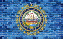 Flagge von New Hampshire auf einer Backsteinmauer Stockbild