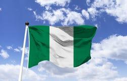 Flagge von Nigeria, von Frieden, von Einheit und von Landwirtschaft stockfotos