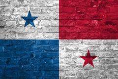 Flagge von Panama über einem alten Backsteinmauerhintergrund, Oberfläche stockbild