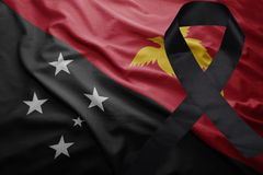 Flagge von Papua-Neu-Guinea mit schwarzem Trauerband Lizenzfreies Stockfoto