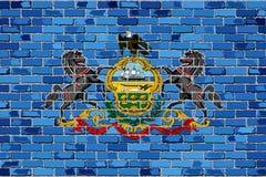 Flagge von Pennsylvania auf einer Backsteinmauer Stockfoto
