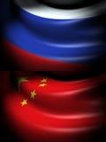 Flagge von Russland und von China Stockfotografie