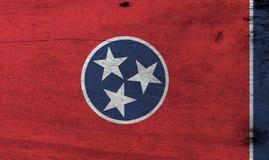 Flagge von Tennessee auf hölzernem Plattenhintergrund Schmutz-Tennessee-Flaggenbeschaffenheit lizenzfreie abbildung