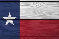 Flagge von Texas auf hölzernem Plattenhintergrund Schmutz-Texas-Flaggenbeschaffenheit lizenzfreie abbildung