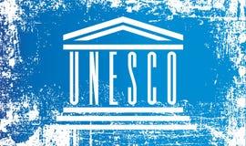Flagge von UNESCO, Organisation der Vereinten Nationen für Erziehung, Wissenschaft und Kultur Geknitterte schmutzige Stellen stock abbildung
