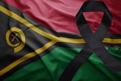 Flagge von Vanuatu mit schwarzem Trauerband Lizenzfreies Stockfoto