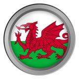 Flagge von Wales-Runde als Knopf lizenzfreie stockfotografie