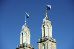 Flagged steeple of Grossmunster, Zurich. Grossmunster cathedral with flagged steeples royalty free stock image