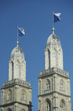 Flagged steeple of Grossmunster, Zurich Stock Photos