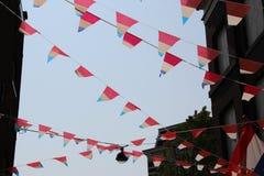 Flaggen in Amsterdam, die Niederlande Lizenzfreies Stockfoto