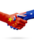Flaggen China, Australien Länder, Partnerschaftsfreundschafts-Händedruckkonzept Abbildung 3D Stockfotografie