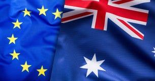 Flaggen des Australiens und der Europäischen Gemeinschaft Australien-Flagge und EU-Flagge Weltflaggenkonzept Lizenzfreie Stockfotos