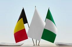 Flaggen von Belgien und von Nigeria lizenzfreies stockfoto